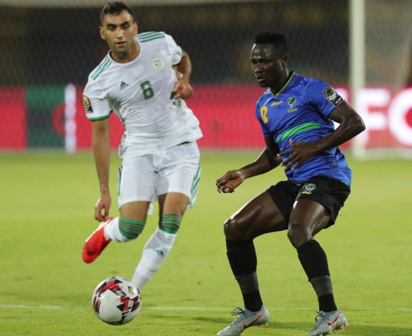 Simon Msuva of Tanzania shields ball from Mohamed Salim Fares of Algeria  during the 2019 Africa Cup of Nations Finals football match between Tanzania and Algeria at the Al Salam Stadium, Cairo, Egypt on 01 July 2019 ©Gavin Barker/BackpagePix