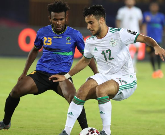 Adam Ounas of Algeria shields ball from Mudathir Yahya of Tanzania  during the 2019 Africa Cup of Nations Finals football match between Tanzania and Algeria at the Al Salam Stadium, Cairo, Egypt on 01 July 2019 ©Gavin Barker/BackpagePix