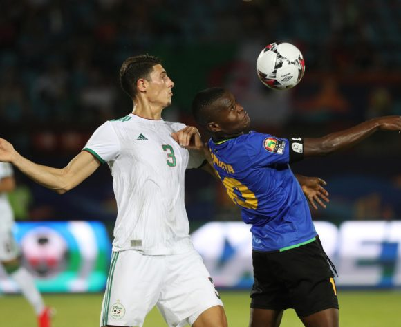 Mbwana Samatta of Tanzania shields ball from Mehdi Sergge Tahrat of Algeria  during the 2019 Africa Cup of Nations Finals football match between Tanzania and Algeria at the Al Salam Stadium, Cairo, Egypt on 01 July 2019 ©Gavin Barker/BackpagePix