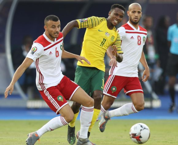 Themba Zwane of South Africa challenged by Ghanem Saiss and Karim El Ahmadi of Morocco during the 2019 Africa Cup of Nations Finals South Africa and Morocco at Al Salam Stadium, Cairo, Egypt on 01 July 2019 ©Samuel Shivambu/BackpagePix