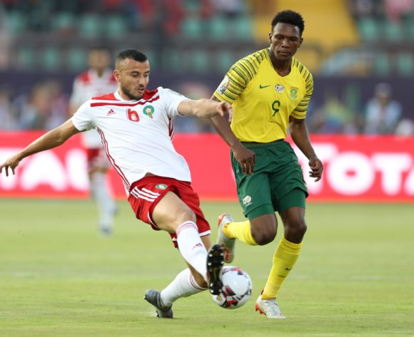 Lebo Mothiba of South Africa tackled by Ghanem Saiss of Morocco during the 2019 Africa Cup of Nations Finals South Africa and Morocco at Al Salam Stadium, Cairo, Egypt on 01 July 2019 ©Samuel Shivambu/BackpagePix