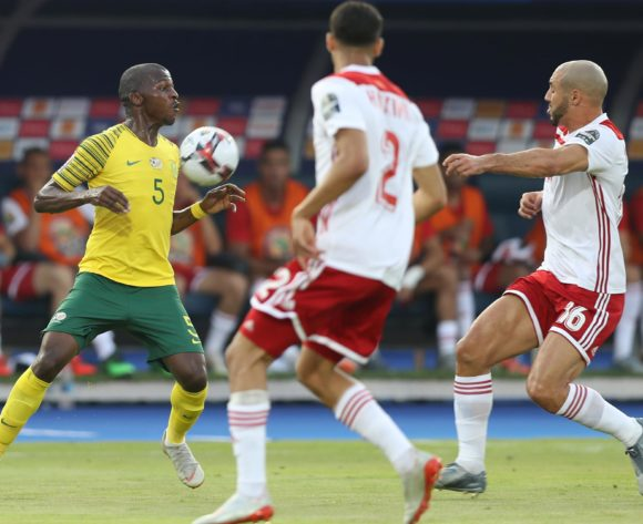 Thamsanqa Mkhize of South Africa challenged by  during the 2019 Africa Cup of Nations Finals South Africa and Morocco at Al Salam Stadium, Cairo, Egypt on 01 July 2019 ©Samuel Shivambu/BackpagePix