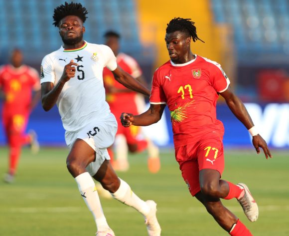 Mama Balde of Guinea-Bissau evades tackle from Thomas Teye Partey of Ghana  during the 2019 Africa Cup of Nations Finals football match between Guinea Bissau and Ghana at the Suez Stadium, Suez, Egypt on 02 July 2019 ©Gavin Barker/BackpagePix