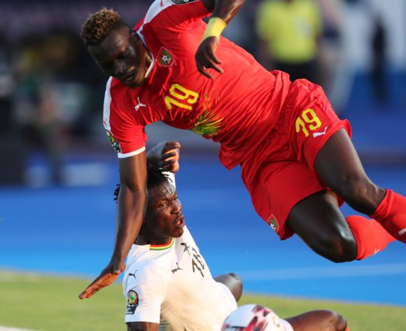 Joseph Aidoo of Ghana fouls Joseph Mendes of Guinea-Bissau during the 2019 Africa Cup of Nations Finals football match between Guinea Bissau and Ghana at the Suez Stadium, Suez, Egypt on 02 July 2019 ©Gavin Barker/BackpagePix