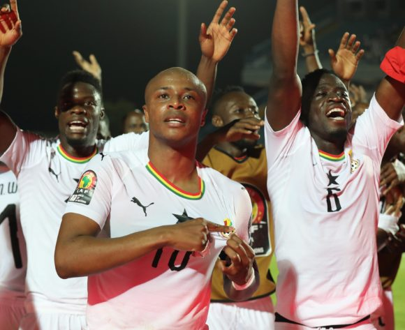 Andre Ayew of Ghana points to emblem as he  leads team in celebration during the 2019 Africa Cup of Nations Finals football match between Guinea Bissau and Ghana at the Suez Stadium, Suez, Egypt on 02 July 2019 ©Gavin Barker/BackpagePix