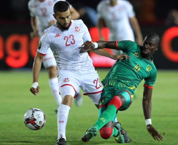 Adama Ba of Mauritania tackled by Sliti Naim of Tunisia  during the 2019 Africa Cup of Nations Finals football match between Mauritania and Tunisia at the Suez Stadium, Suez, Egypt on 02 July 2019 ©Gavin Barker/BackpagePix