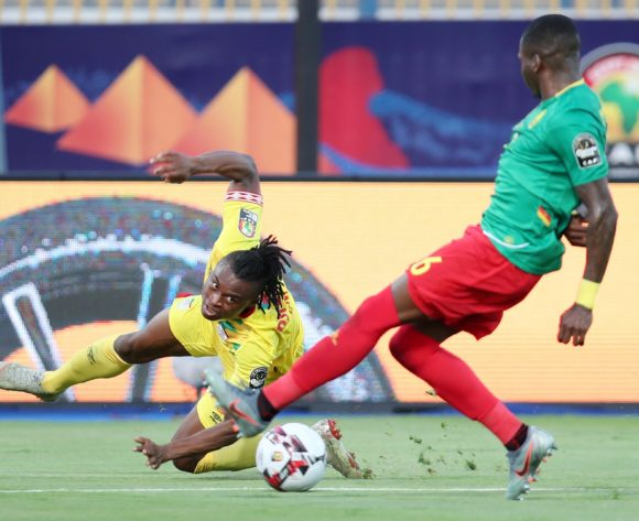 David Djigla of Benin challenged by Ambroise Oyongo of Cameroon during the 2019 Africa Cup of Nations match between Benin and Cameroon at the Ismailia Stadium, Ismailia on the 02 July 2019 ©Muzi Ntombela/BackpagePix