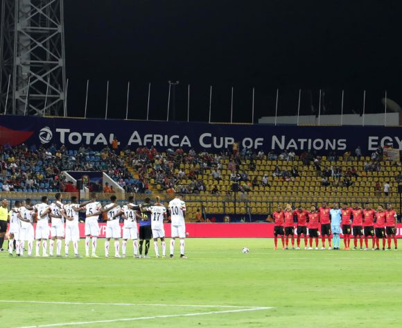 Players observe moment of silence for former DR Congo striker Pierre Ndaye Mulamba during the 2019 Africa Cup of Nations match between Angola and Mali at the Ismailia Stadium, Ismailia on the 02 July 2019 ©Muzi Ntombela/BackpagePix