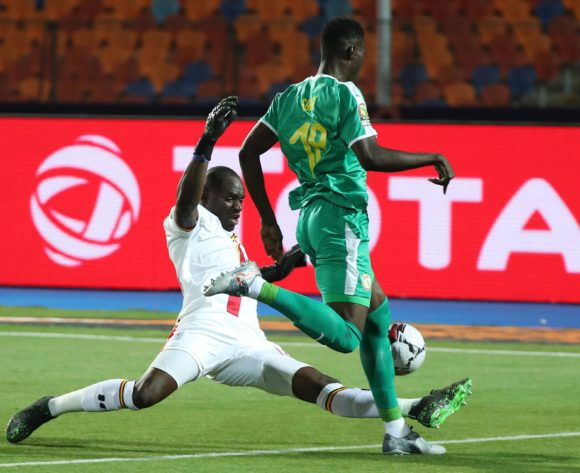 Denis Onyango of Uganda fouls Ismaila Sarr of Senegal during the 2019 Africa Cup of Nations Finals last 16 match between Uganda and Senegal at the Al Salam Stadium in Cairo, Egypt on 05 July 2019 ©BackpagePix