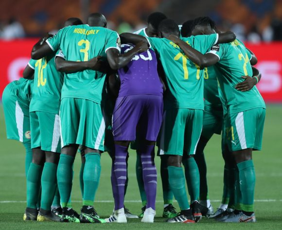 Senegal players praying during the 2019 Africa Cup of Nations Finals last 16 match between Uganda and Senegal at Cairo International Stadium, Cairo, Egypt on 05 July 2019 ©Samuel Shivambu/BackpagePix