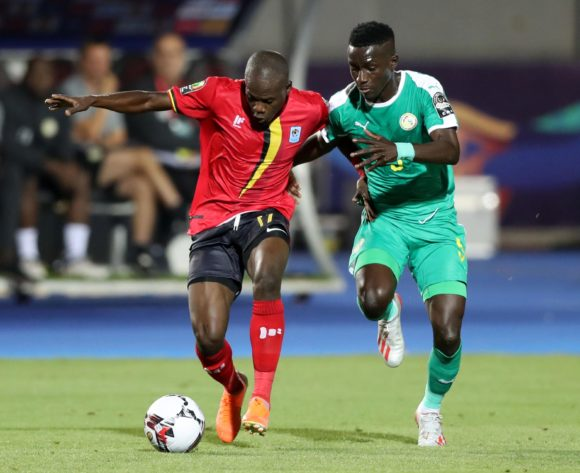 Faruku Miya of Uganda challenged by Idrissa Gana Gueye of Senegal during the 2019 Africa Cup of Nations Finals last 16 match between Uganda and Senegal at Cairo International Stadium, Cairo, Egypt on 05 July 2019 ©Samuel Shivambu/BackpagePix