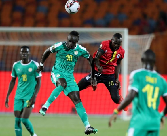 Sadio Mane of Senegal challenged by Godfrey Walusimbi of Uganda during the 2019 Africa Cup of Nations Finals last 16 match between Uganda and Senegal at Cairo International Stadium, Cairo, Egypt on 05 July 2019 ©Samuel Shivambu/BackpagePix