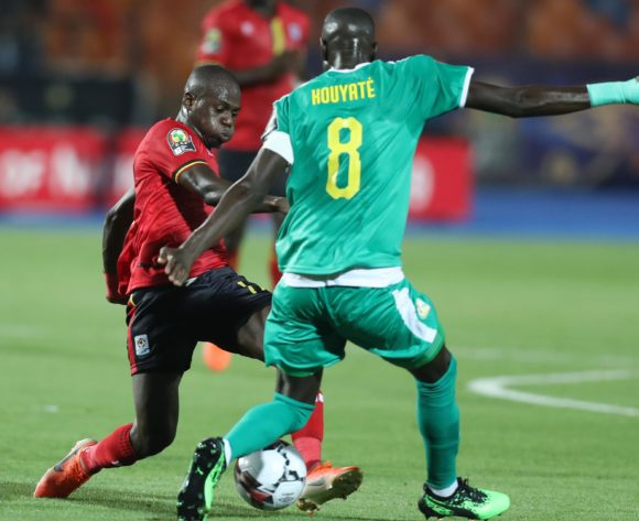 Faruku Miya of Uganda challenged by Cheikhou Kouyate of Senegal during the 2019 Africa Cup of Nations Finals last 16 match between Uganda and Senegal at Cairo International Stadium, Cairo, Egypt on 05 July 2019 ©Samuel Shivambu/BackpagePix