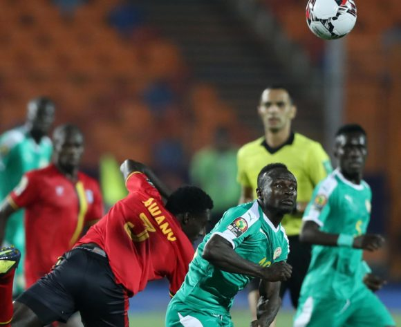 Sadio Mane of Senegal challenged by Timothy Dennis Awany of Uganda during the 2019 Africa Cup of Nations Finals last 16 match between Uganda and Senegal at Cairo International Stadium, Cairo, Egypt on 05 July 2019 ©Samuel Shivambu/BackpagePix