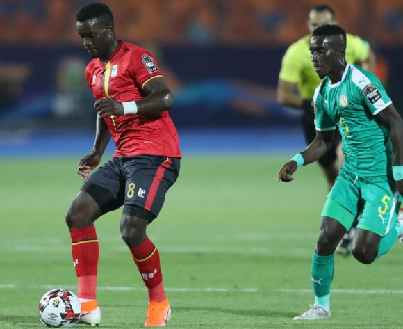Khalid Aucho of Uganda challenged by Idrissa Gana Gueye of Senegal during the 2019 Africa Cup of Nations Finals last 16 match between Uganda and Senegal at Cairo International Stadium, Cairo, Egypt on 05 July 2019 ©Samuel Shivambu/BackpagePix