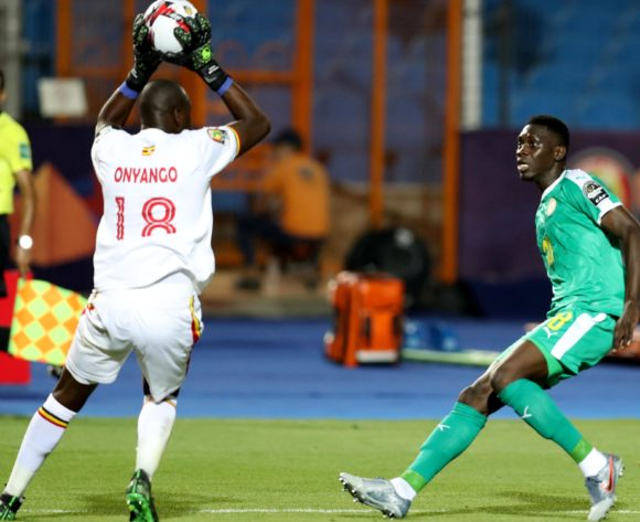 Denis Onyango of Uganda challenged by Ismaila Sarr of Senegal during the 2019 Africa Cup of Nations Finals last 16 match between Uganda and Senegal at Cairo International Stadium, Cairo, Egypt on 05 July 2019 ©Samuel Shivambu/BackpagePix