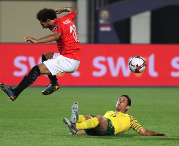 Dean Furman of South Africa tackles Mohamed Salah of Egypt  during the 2019 Africa Cup of Nations Finals Last 16 football match between Egypt and South Africa at the Cairo International Stadium, Cairo, Egypt on 06 July 2019 ©Gavin Barker/BackpagePix
