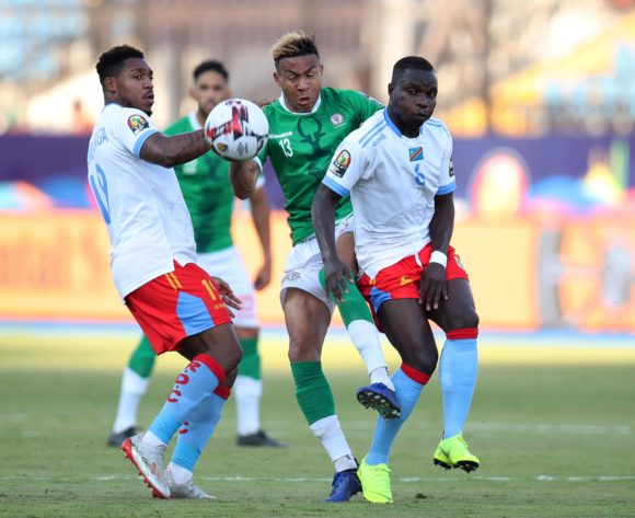 Anicet Andrianantenaina of Madagascar challenged by Chadrack Akolo and Britt Assombalonga of DR Congo during the 2019 Africa Cup of Nations Last 16 match between Madagascar and DR Congo at the Alexandria Stadium, Alexandria on the 07 July 2019 ©Muzi Ntombela/BackpagePix
