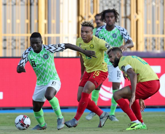 Peter Etebo of Nigeria challenged by Eric Maxim Choupo-Moting of and Pierre Kunde Malong of Cameroon during the 2019 Africa Cup of Nations Last 16 match between Nigeria and Cameroon at the Alexandria Stadium, Alexandria on the 06 July 2019 ©Muzi Ntombela/BackpagePix