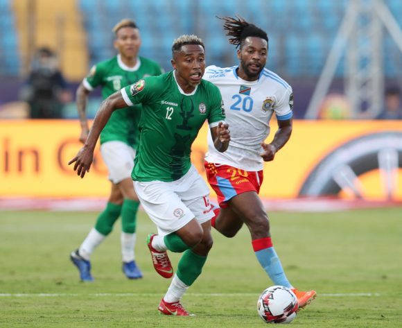 Lalaina Henintsoa Enjanahary of Madagascar challenged by Jacques Maghoma of DR Congo during the 2019 Africa Cup of Nations Last 16 match between Madagascar and DR Congo at the Alexandria Stadium, Alexandria on the 07 July 2019 ©Muzi Ntombela/BackpagePix