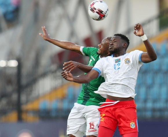 Ibrahim Samuel Amada of Madagascar challenged by Wilfred Moke of DR Congo during the 2019 Africa Cup of Nations Last 16 match between Madagascar and DR Congo at the Alexandria Stadium, Alexandria on the 07 July 2019 ©Muzi Ntombela/BackpagePix