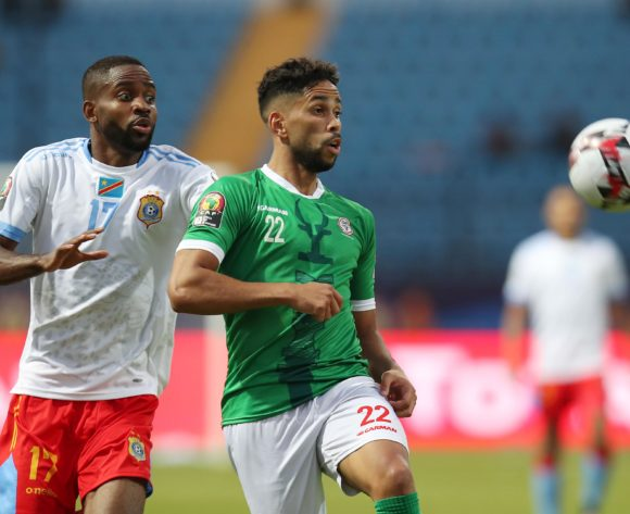Charles Carolus Andrea of Madagascar challenged by Cedric Bakambu of DR Congo during the 2019 Africa Cup of Nations Last 16 match between Madagascar and DR Congo at the Alexandria Stadium, Alexandria on the 07 July 2019 ©Muzi Ntombela/BackpagePix