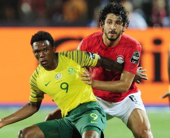 Lebo Mothiba of South Africa is challenged by Ahmed Hegazi of Egypt during the 2019 Africa Cup of Nations Finals last 16 match between Egypt and South Africa at Cairo International Stadium in Cairo, Egypt on 06 July 2019 © Ryan Wilkisky/BackpagePix