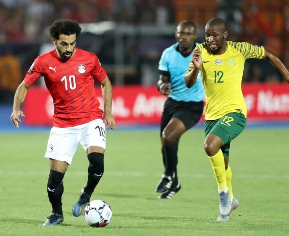 Mohamed Salah of Egypt challenged by Kamohelo Mokotjo of South Africa during the 2019 Africa Cup of Nations Finals last 16 match between Egypt and South Africa at Cairo International Stadium, Cairo, Egypt on 06 July 2019 ©Samuel Shivambu/BackpagePix