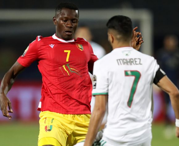 Mady Camara of Guinea challenged by Riyad Mahrez of Algeria during the 2019 Africa Cup of Nations Finals last 16 match between Algeria and Guinea at 30 June Stadium, Cairo, Egypt on 07 July 2019 ©Samuel Shivambu/BackpagePix