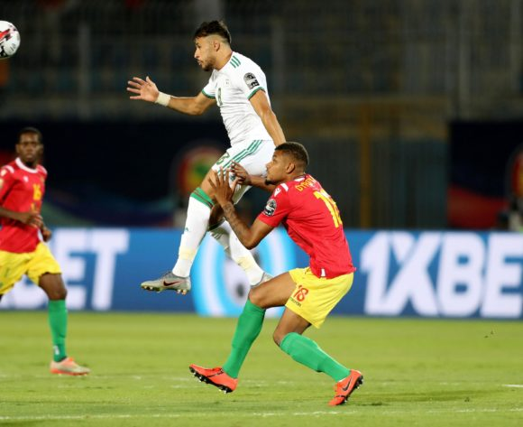 Mohamed Belaili of Algeria challenged by Mikael Dyrestam of Guinea during the 2019 Africa Cup of Nations Finals last 16 match between Algeria and Guinea at 30 June Stadium, Cairo, Egypt on 07 July 2019 ©Samuel Shivambu/BackpagePix