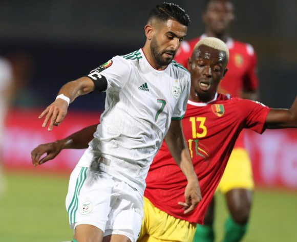 Riyad Mahrez of Algeria challenged by Ibrahima Cisse of Guinea during the 2019 Africa Cup of Nations Finals last 16 match between Algeria and Guinea at 30 June Stadium, Cairo, Egypt on 07 July 2019 ©Samuel Shivambu/BackpagePix