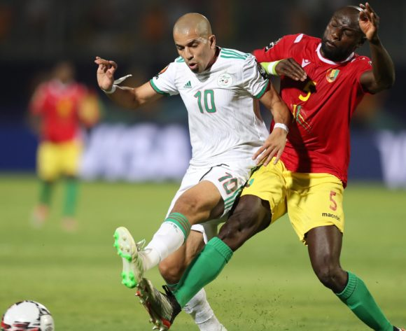 Sofiane Feghouli of Algeria challenged by Ernest Seka of Guinea during the 2019 Africa Cup of Nations Finals last 16 match between Algeria and Guinea at 30 June Stadium, Cairo, Egypt on 07 July 2019 ©Samuel Shivambu/BackpagePix