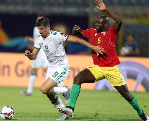 Baghdad Bounedjah of Algeria challenged by Ernest Seka of Guinea during the 2019 Africa Cup of Nations Finals last 16 match between Algeria and Guinea at 30 June Stadium, Cairo, Egypt on 07 July 2019 ©Samuel Shivambu/BackpagePix