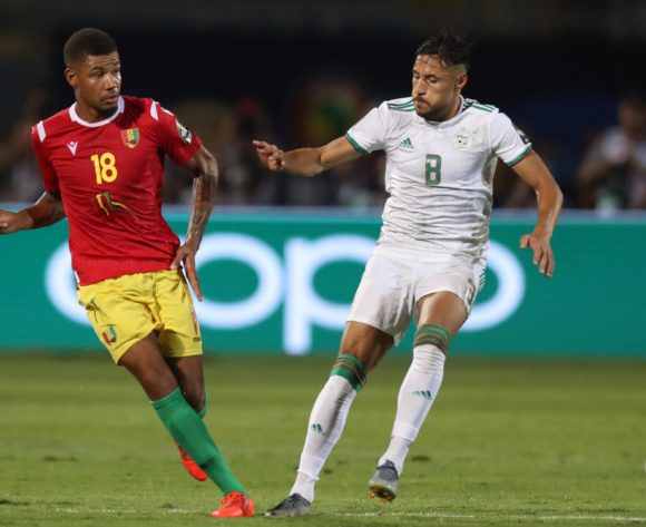 Mikael Dyrestam of Guinea challenged by Mohamed Belaili of Algeria during the 2019 Africa Cup of Nations Finals last 16 match between Algeria and Guinea at 30 June Stadium, Cairo, Egypt on 07 July 2019 ©Samuel Shivambu/BackpagePix