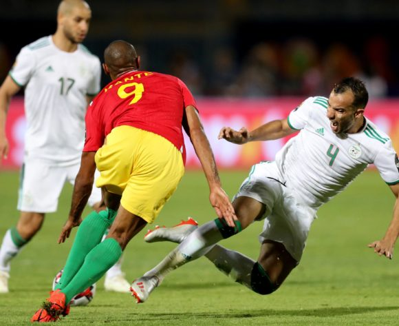 Djamel Benlamri of Algeria challenged by Martinez Kante of Guinea during the 2019 Africa Cup of Nations Finals last 16 match between Algeria and Guinea at 30 June Stadium, Cairo, Egypt on 07 July 2019 ©Samuel Shivambu/BackpagePix