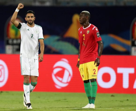 Riyad Mahrez of Algeria celebrates goal as Mohamed Yattara of Guinea looks on during the 2019 Africa Cup of Nations Finals last 16 match between Algeria and Guinea at 30 June Stadium, Cairo, Egypt on 07 July 2019 ©Samuel Shivambu/BackpagePix