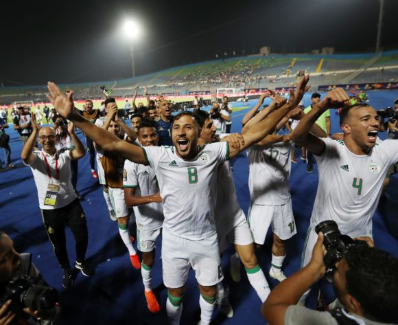 Mohamed Belaili (8) of Algeria celebrates a victory with teammates during the 2019 Africa Cup of Nations Finals last 16 match between Algeria and Guinea at 30 June Stadium, Cairo, Egypt on 07 July 2019 ©Samuel Shivambu/BackpagePix