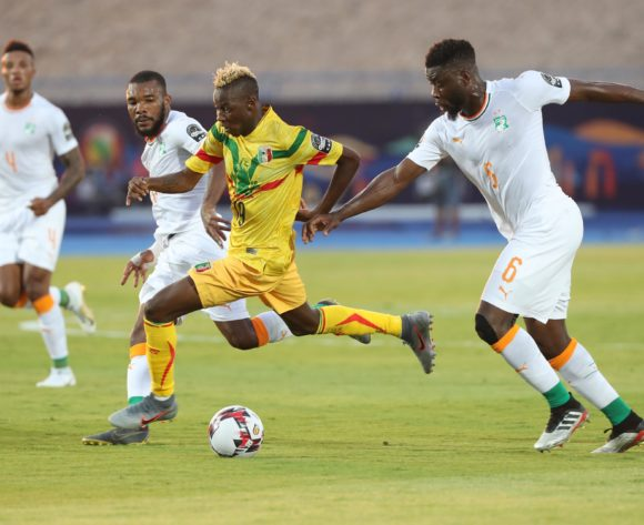 Moussa Djenepo of Mali challenged by Ismael Traore of Ivory Coast  during the 2019 Africa Cup of Nations Finals Last 16 football match between Ivory Coast and Mali at the Suez Stadium, Suez, Egypt on 08 July 2019 ©Gavin Barker/BackpagePix