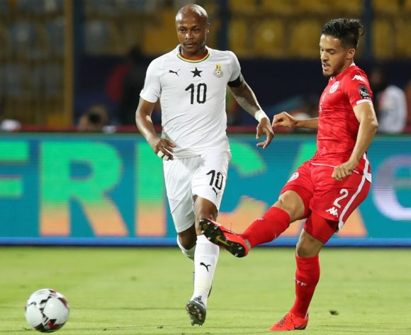 Wajdi Kechrida of Tunisia challenged by Andre Ayew of Ghana during the 2019 Africa Cup of Nations Last 16 match between Ghana and Tunisia at the Ismailia Stadium, Ismailia on the 08 July 2019 ©Muzi Ntombela/BackpagePix