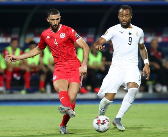 Yassine Merriah of Tunisia challenged by Jordan Ayew of Ghana during the 2019 Africa Cup of Nations Last 16 match between Ghana and Tunisia at the Ismailia Stadium, Ismailia on the 08 July 2019 ©Muzi Ntombela/BackpagePix