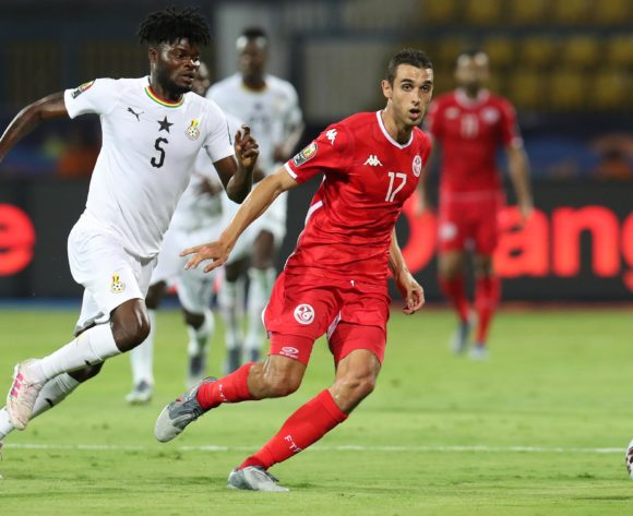 Ellyes Joris Skhiri of Tunisia challenged by Thomas Teye Partey of Ghana during the 2019 Africa Cup of Nations Last 16 match between Ghana and Tunisia at the Ismailia Stadium, Ismailia on the 08 July 2019 ©Muzi Ntombela/BackpagePix