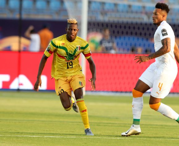 Jean Pphilippe Gbamin of Ivory Coast challenged by Moussa Djenepo of Mali during the 2019 Africa Cup of Nations Finals last 16 match between Mali and Ivory Coast at Suez Stadium, Suez, Egypt on 08 July 2019 ©Samuel Shivambu/BackpagePix