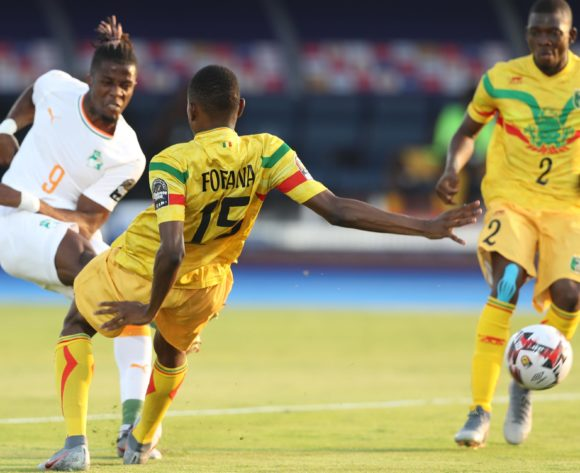 Wilfried Zaha of Ivory Coast challenged by Mamadou Fofana of Mali during the 2019 Africa Cup of Nations Finals last 16 match between Mali and Ivory Coast at Suez Stadium, Suez, Egypt on 08 July 2019 ©Samuel Shivambu/BackpagePix