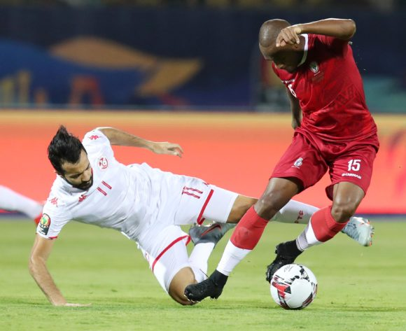 Taha Yassine Khenissi of Tunisia fouled by Ibrahim Samuel Amada  of Madagascar during the 2019 Africa Cup of Nations Quarterfinals match between Madagascar and Tunisia at the Al Salam Stadium, Cairo on the 10 July 2019 ©Muzi Ntombela/BackpagePix