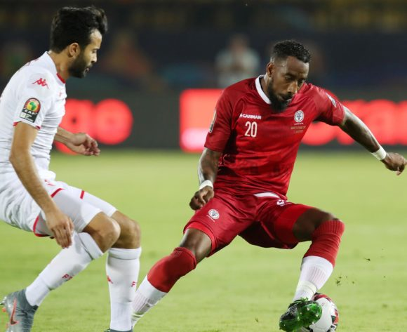 Romain Metanire of Madagascar challenged by Taha Yassine Khenissi of Tunisia during the 2019 Africa Cup of Nations Quarterfinals match between Madagascar and Tunisia at the Al Salam Stadium, Cairo on the 10 July 2019 ©Muzi Ntombela/BackpagePix