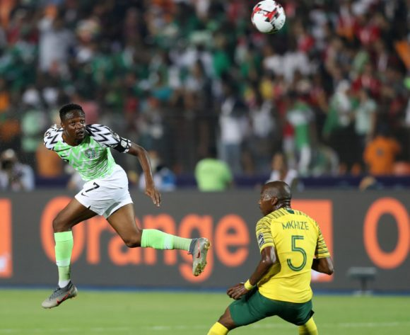 Ahmed Musa of Nigeria challenged by Thamsanqa Mkhize of South Africa during the 2019 Africa Cup of Nations Finals, quarterfinals match between Nigeria and South Africa at Cairo International Stadium, Cairo, Egypt on 10 July 2019 ©Samuel Shivambu/BackpagePix