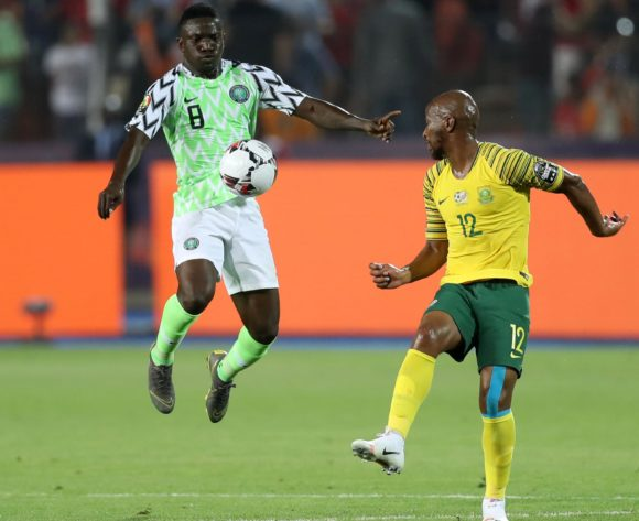 Peter Etebo of Nigeria challenged by Kamohelo Mokotjo of South Africa during the 2019 Africa Cup of Nations Finals, quarterfinals match between Nigeria and South Africa at Cairo International Stadium, Cairo, Egypt on 10 July 2019 ©Samuel Shivambu/BackpagePix