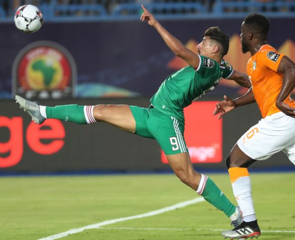 Baghdad Bounedjah of Algeria stretches for ball, challenged by Ismael Traore of Ivory Coast during the 2019 Africa Cup of Nations Finals Quarterfinal football match between Ivory Coast and Algeria at the Suez Stadium, Suez, Egypt on 08 July 2019 ©Gavin Barker/BackpagePix