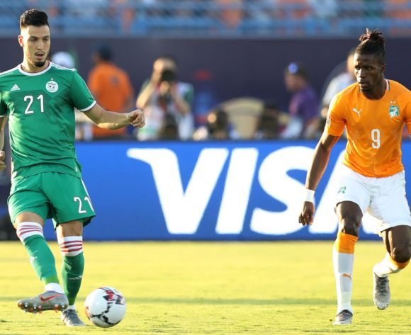 Rami Bensebaini of Algeria challenged by Wilfried Zaha of Ivory Coast during the 2019 Africa Cup of Nations Finals, quarterfinals match between Ivory Coast and Algeria at Suez Stadium, Suez, Egypt on 11 July 2019 ©Samuel Shivambu/BackpagePix