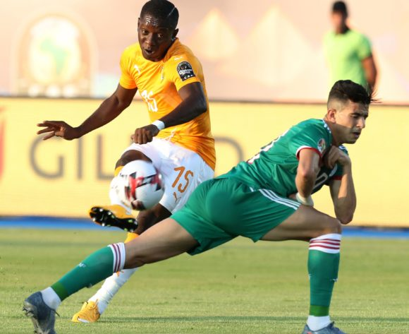 Max Gradel of Ivory Coast challenged by Youcef Atal of Algeria during the 2019 Africa Cup of Nations Finals, quarterfinals match between Ivory Coast and Algeria at Suez Stadium, Suez, Egypt on 11 July 2019 ©Samuel Shivambu/BackpagePix